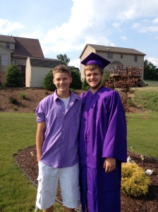 The graduate and his baby brother!